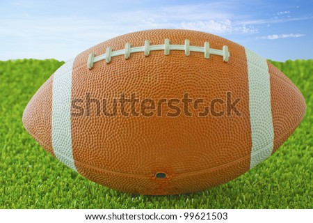 Close up of a football over green grass