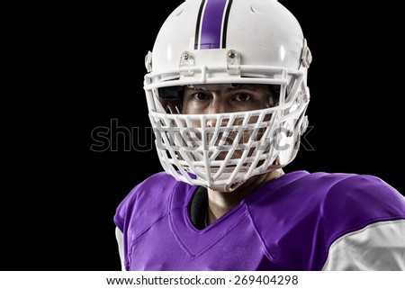 Close up of a Football Player with a purple uniform on a black background.