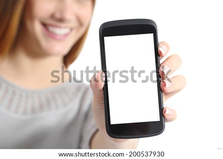 Close up of a funny woman holding a blank smart phone screen isolated on a white background            - stock photo