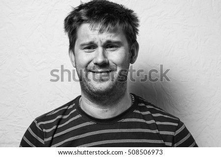 Close up of a funny young man. The collage of young man with different emotion. emotional card. Black-and-white photo.