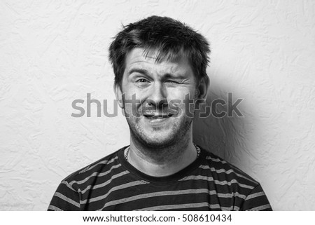 Close up of a funny young man with different emotion. Doubt. Emotional card. Black-and-white photo.