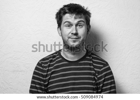 Close up of a funny young man with different emotion. Surprise. Emotional card. Black-and-white photo.