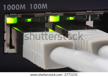 Close-up of a gigabit switch and two plugged cat6 network cables