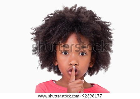 Close up of a girl asking silence against a white background - stock photo