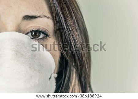 Close-up of a girl's face wearing a mask to defend - concept of smog, pollution, contagious diseases - stock photo