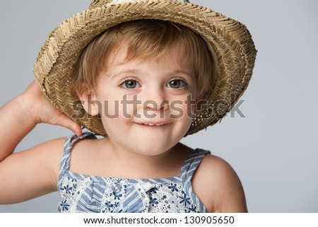 Close-up of a girl standing with Straw Hat. - stock photo