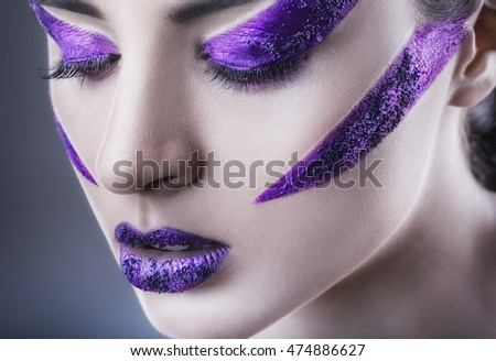 Close Up of a glamour portrait of beautiful woman model with bright purple makeup