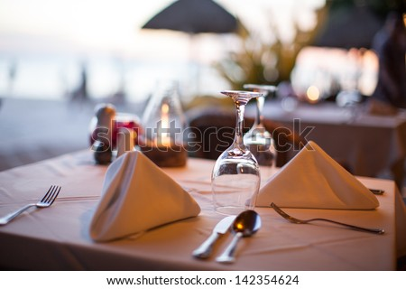 Close-up of a glass in a restaurant in the evening - stock photo