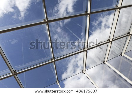 Close up of a glass roof and blue sky