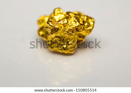 Close-up of a gold-nugget - stock photo