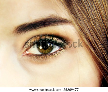 Close up of a golden eye make up - stock photo