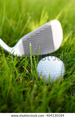 Close up of a golf club and ball