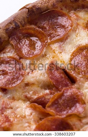 Close-up of a greasy pepperoni pizza
