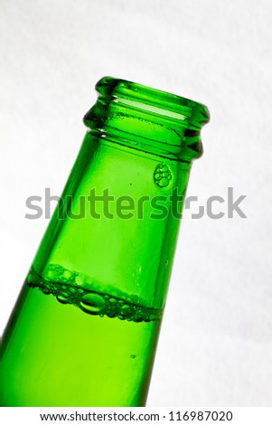 Close up of a green beer bottle on white. - stock photo