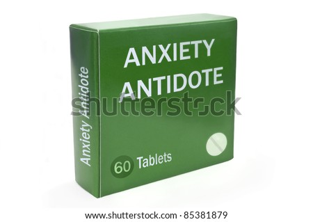 """Close up of a green box with the words """"ANXIETY ANTIDOTE"""" arranged over white. - stock photo"""