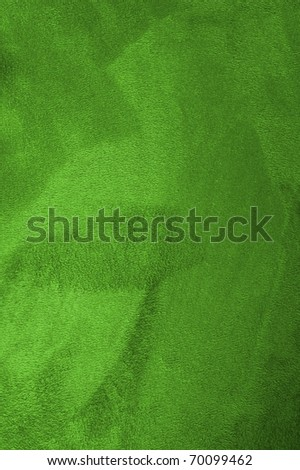 close up of a green coat, fur texture to background - stock photo