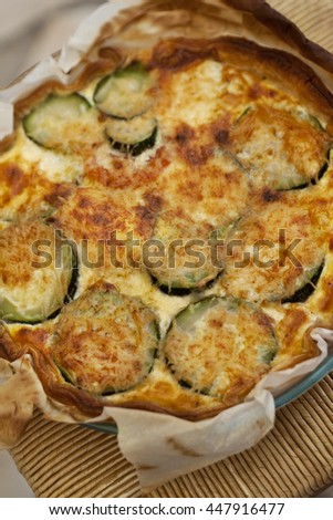 Close up of a grilled zucchini pie in a kitchen