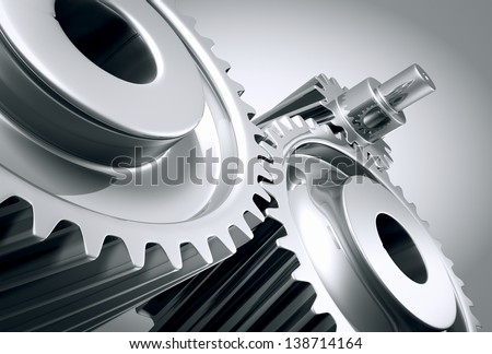 Close up of a group of interlocking stainless steel gears. - stock photo