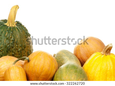 Close up of a group of pumpkins of different shapes and sizes - stock photo
