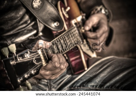 close up of a guitar player in hdr tone mapping - stock photo