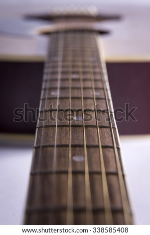 Close-up of a guitar's fretboard