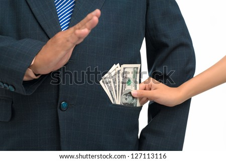 Close up of a hand giving a bribe