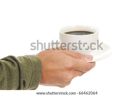 Close up of a hand holding a cup of black coffee - stock photo
