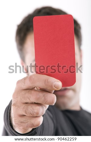 Close up of a hand holding a red card - stock photo