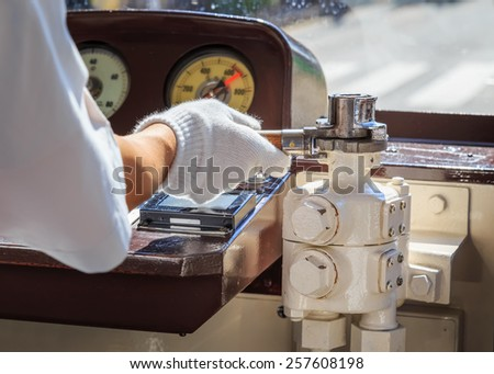 Close up of a hand of a japanese Tram Driver