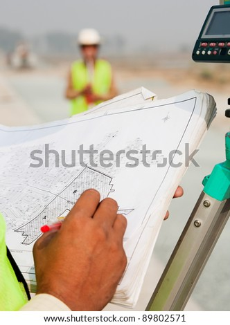 close up of a hand on an architectural map - stock photo