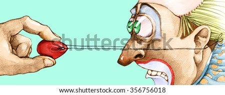 close-up of a hand pulling the nose of a clown scared - stock photo