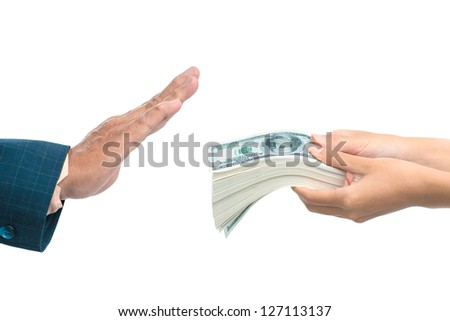 Close up of a hand refusing a bribe