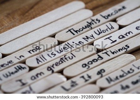 close up of a hand written message on a popsicle stick as a self esteem building concept