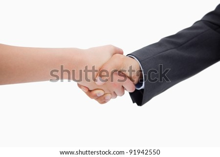 Close up of a handshake against a white background
