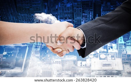 Close up of a handshake against new york - stock photo