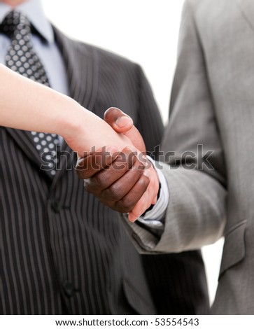 Close-up of a handshake between two businesspeople in the office