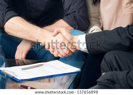 Close-up of a handshake of two people - stock photo