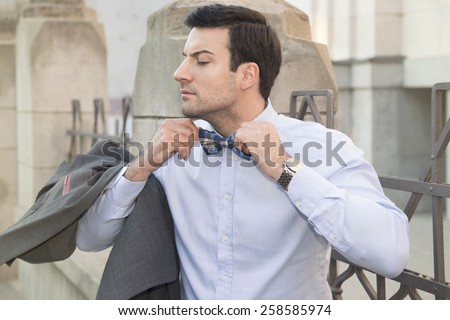 Close-up of a handsome man getting ready for a date - stock photo