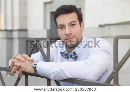 Close up of a handsome young gentleman - stock photo