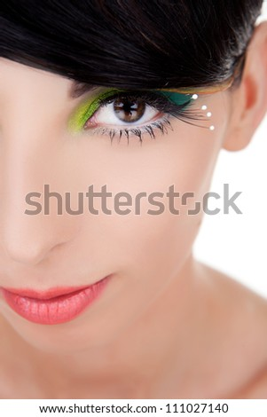 Close-up of a happy beautiful young woman looking at camera. young woman model with excentric make-up smiling. - stock photo