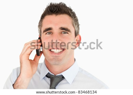 Close up of a happy businessman making a phone call against a white background