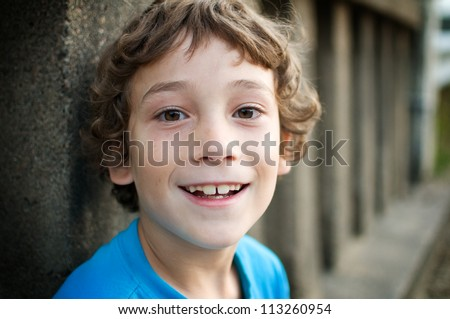 close up of a happy little boy - stock photo