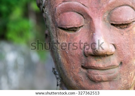 close up of a happy smile buddha's face