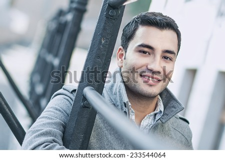 Close-up of a happy smile man wearing coat, coldly morning. Autumn day - stock photo