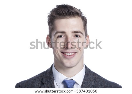 Close-up of a happy young businessman on white background. - stock photo