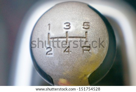 Close-up of a head modern 5 speed manual gearshift (gear stick, gear shift, gear knob) - stock photo