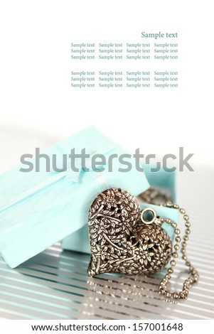 Close-up of a heart necklace in a gift box - stock photo