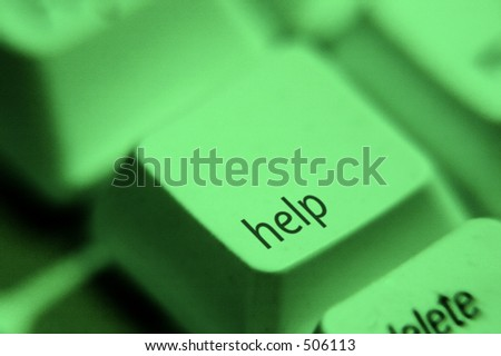 Close-up of a help key. Toned in green. - stock photo