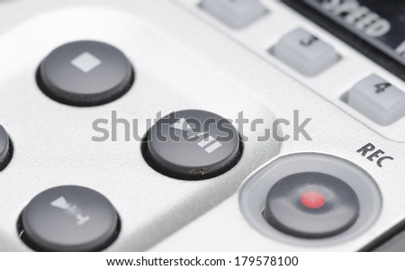 Close up of a high tech media player button. Macro shot with very shallow depth of field. - stock photo