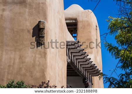 close up of a home in the American South west with a beautiful stucco finish - stock photo